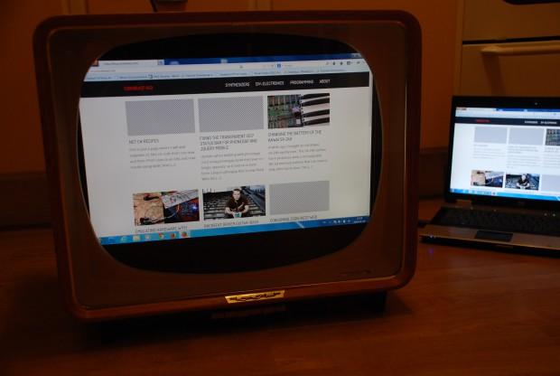 Vintage TV set with modern screen inside
